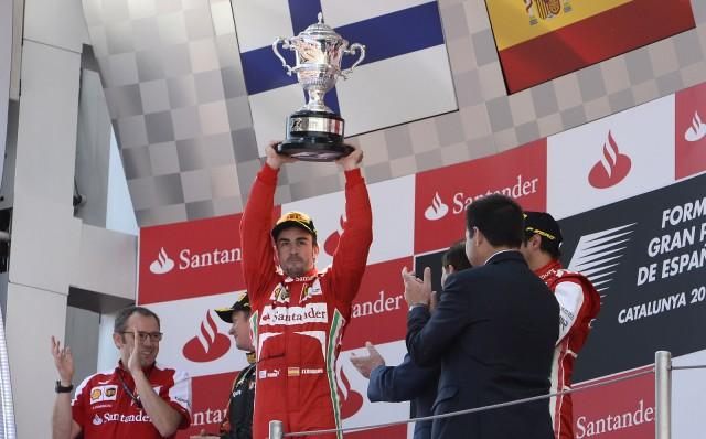 ferraris-fernando-alonso-after-winning-the-2013-formula-1-spanish-grand-prix_100427052_m