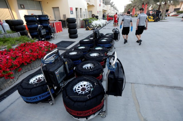 Tyres in blankets are lined up in the paddock